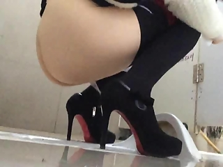 YourVoyeurVideos  Woman in high heels caught in public toilet pissing PaysiteRip VoyeurXXX